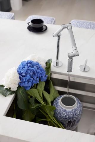 Karbon kitchen faucet    Prolific sink    The innovative flexibility of the Karbon kitchen faucet makes a splash in this modern space.