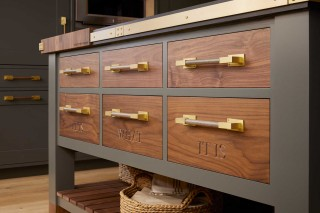 "One of Peacock's father's favorite sayings, ""It is what it is"" is carved into the wood drawers, both a subtle nod to his parents and a playful reference to the drawers' contents."