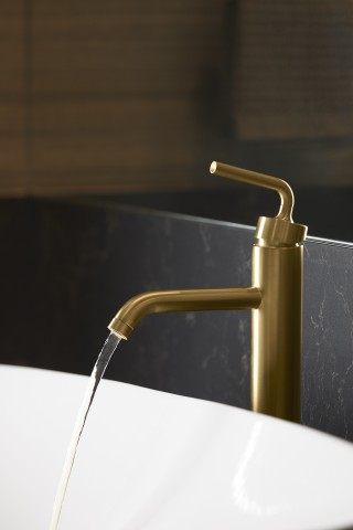 Veil™ trough vessel bathroom sink    Purist® bathroom sink faucet    The clean lines and soft curvatures of the Purist faucet complete the minimalist aesthetic of the room.