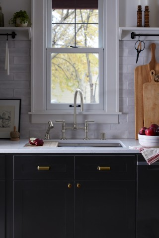 Hi-Rise kitchen faucet    Hi-Rise sidespray    Prolific kitchen sink    A bridge faucet and sidespray add a classic old-world touch with decidedly modern functionality.
