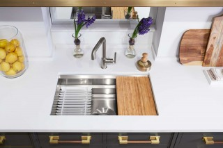 Purist Single-Handle Faucet    Prolific Kitchen Sink    Graduated ledges in the workstation sink accommodate a range of accessories to make kitchen tasks cleaner and more efficient.
