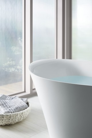 Veil Freestanding Bath    The balance of curves in this freestanding bath isn't just for show, it's ergonomically designed to support your body as you focus on your well-being.