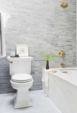 Memoirs Stately Comfort Height toilet    Finial Traditional bath and shower trim set    Archer under-mount bath    Wall tile, like lovingly faded denim, provides a comforting backdrop for the crisp edges of the toilet and bath.