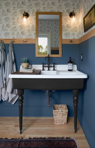 Farmstead sink    Farmstead transitional legs    Artifacts faucet    Originally designed for the kitchen, this cast iron sink is right at home here in the bathroom, providing extra wash space and functionality.