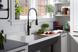 Tournant® semiprofessional kitchen faucet    Farmstead™ freestanding sink    The Farmstead cutting board boosts the functionality of this utility sink.