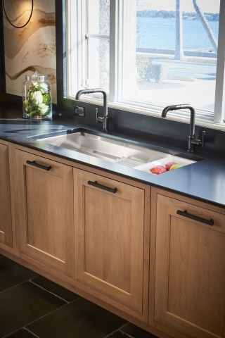 Purist faucet    Prolific kitchen sink    Dual faucets pair with a workstation sink to meet the multifunctional needs of entertaining, all while affording inspirational views of the water beyond.