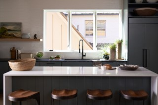 Purist faucet    Prolific sink    The bright white island top and dark gray counter top create balance through contrast.