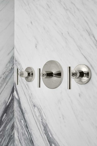 Purist Valve Trim    A marble pattern in the shower adds elegance and complements the finishes of the shower accessories.