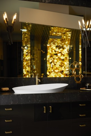 Veil™ trough vessel bathroom sink    Purist® bathroom sink faucet    Gold accents and the Vibrant® Moderne Brushed Gold faucet finish radiate luxurious warmth throughout the room.