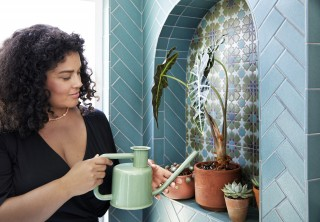 Adding an alcove above the bath creates more room for storage or, in this case, plants that contribute to the nature-inspired bathroom.