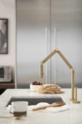 Karbon® faucet    The Vibrant Brushed Bronze finish of the faucet adds a soft, warm element that balances the cooler elements in the room.