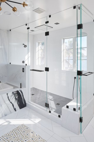 Real Rain overhead panel    Purist showerhead    WaterTile body spray    Overhead and full-body showers offer a sense of connection to the water vistas beyond.