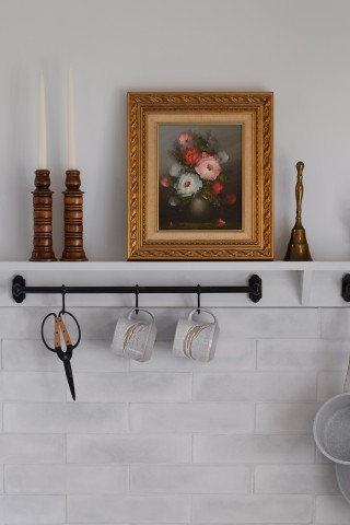 An eye-level shelf and hanging rod let Radosevich show off her eclectic tastes while putting frequently used objects within easy reach.