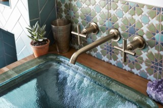 Inia Bathroom Sink    Purist Sink Faucet     The Vibrant® Brushed Bronze finish of the Purist® faucet and handles provides a warm complement to the cool blues seen throughout the bathroom.