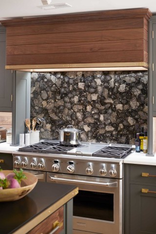 This captivating backsplash creates a bold and dramatic centerpiece without drawing too much attention away from the rest of the room.