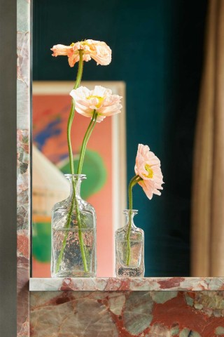 Wispy and delicate poppies imbue the room with life and a notion of delicate ephemerality, uniquely fitting for this vintage-inspired space.