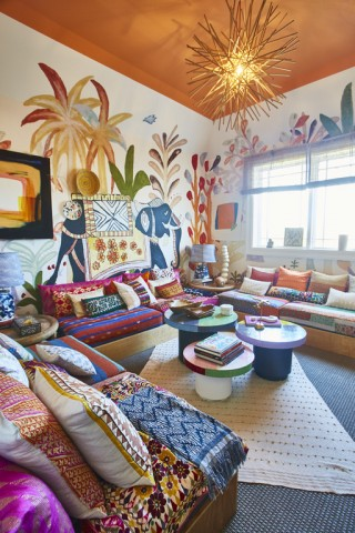 There's no space for a sad thought in this warm and vibrant front bedroom inspired by the jungles and textiles of India.