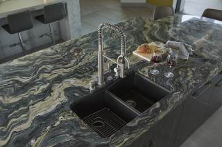 Riverby® kitchen sink    Purist® semiprofessional kitchen faucet    The flowing, organic pattern of the natural quartzite counter balances the clean lines and exacting geometry of the rest of the kitchen. This stunning material was also used as an exterior chimney facade.