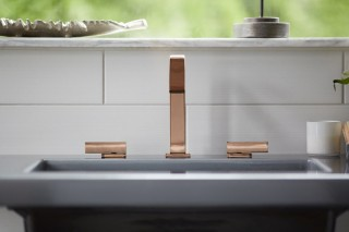 Loure® bathroom sink faucet    Kathryn® console table top    The Vibrant® Rose Gold faucet finish adds a pop of whimsical color.