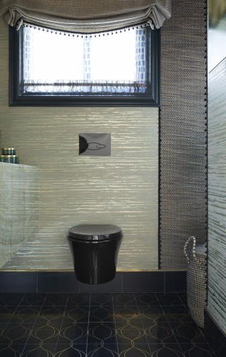 Veil Wall-Hung Toilet   Droplet Actuator Plate   The wall-hung, black finish Veil toilet seems suspended in midair and blends into the darker color scheme of the room.