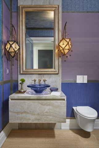 Spun Glass® bathroom sink    Purist® wall-mount bathroom sink faucet    Veil® wall-hung toilet    Lush colors bordered with intricate patterns and gold finishes give the powder room an oriental exoticism perfectly suited for a sultan of Wall Street.