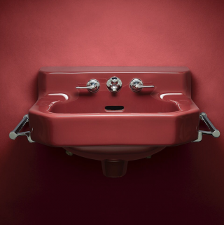 Like a delicious side of cranberries, this wall-mount sink accented a bathroom of colorful fixtures. While this original dates back to 1940, you can still find a full serving of today's wall-mount options.   Wall-Mount Sinks