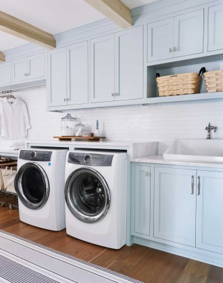 Hollister utility sink     Artifacts single-handle bathroom sink faucet    The baby blue cabinets, blond wood beams and light-colored stone countertop create a clean, fresh experience, perfect for a laundry room.