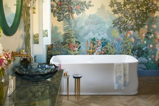Purist Wall-Mount Faucet    Briolette Vessel Sink    Purist Floor-Mount Bath Filler    Imperator Freestanding Bath    A floral motif wall mural creates an added sense of space and nature, nicely complemented by the warm brushed gold finishes in this master bath spa.