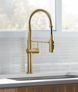 A simple arched spout and single-lever handle offer a straightforward, sophisticated style that adapts to nearly any kitchen design.    Crue™ Semiprofessional Kitchen Faucet