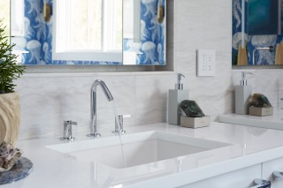Verticyl under-mount sink    Verdera lighted mirror    Stillness faucet    A modern sink and faucet make a sleek styling space for any occasion.