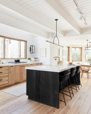 Whitehaven® kitchen sink    Purist® kitchen faucet    The black-stained wood island adds a bold and dramatic centerpiece that solidly grounds the aesthetic with a modern sensibility.