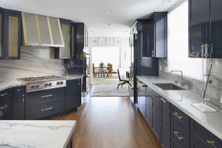 Strive Kitchen Sink    Purist Kitchen Faucet    Marbled countertops and blue hue keep the kitchen uncluttered and breezy.