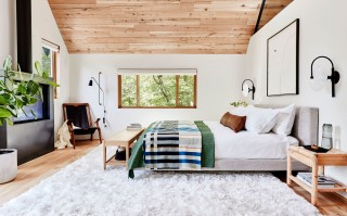 Soft neutral colors, minimalist forms and pitched ceilings, all looking out to nature, create a calming and centering master bedroom. A perfect place to wake up refreshed and focused.