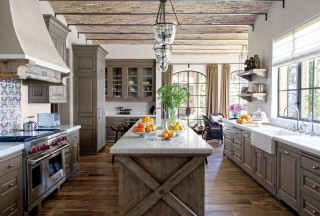 Rustic Kitchen by Joan Behnke & Associates Inc. and Landry Design Group Inc. in Los Angeles, California